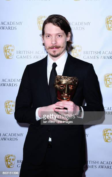 Lucas Pope with the Strategy and Simulation award for Papers Please at the British Academy Games Awards at Tobacco Dock London