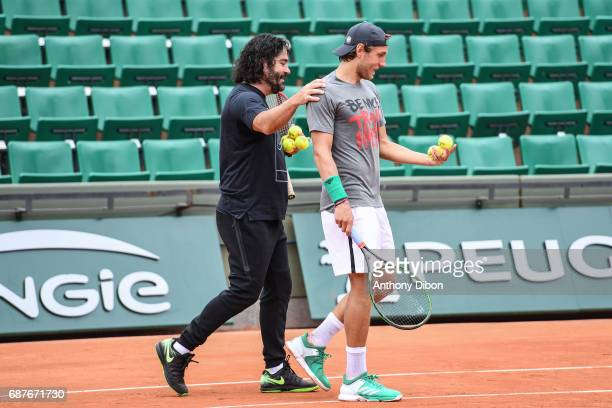 Lucas Pouille and his coach Emmanuel Planque during qualifying match of the 2017 French Open at Roland Garros on May 24 2017 in Paris France