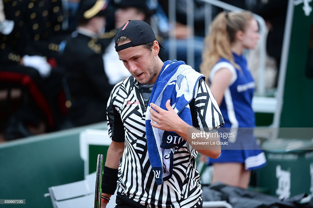 Lucas Pouille is dejected during the Men's Singles first round on day three of the French Open 2016 at Roland Garros on May 24, 2016 in Paris, France.