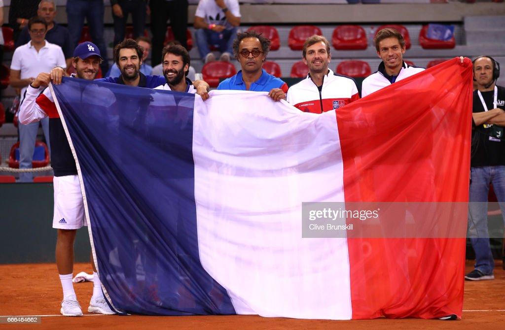 Lucas Pouille, Jeremy Chardy, Jonathan Eysseric, captain Yannick Noah, Julien Benneteau and Nicolas Mahut of France celebrate their victory against Great Britain on day 3 of the Davis Cup World Group Quarter-Final match between France and Great Britain at Kindarena on April 9, 2017 in Rouen, France.