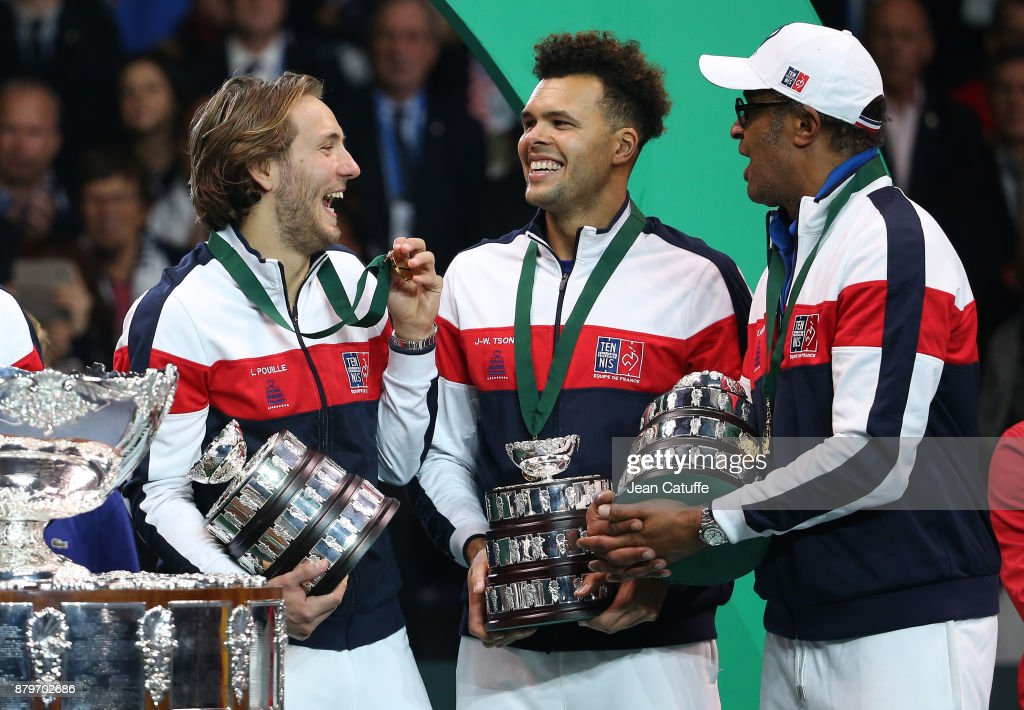 Lucas Pouille, Jo-Wilfried Tsonga, captain of France Yannick Noah celebrate winning the Davis Cup during the trophy presentation on day 3 of the Davis Cup World Group final between France and Belgium at Stade Pierre Mauroy on November 26, 2017 in Lille, France.