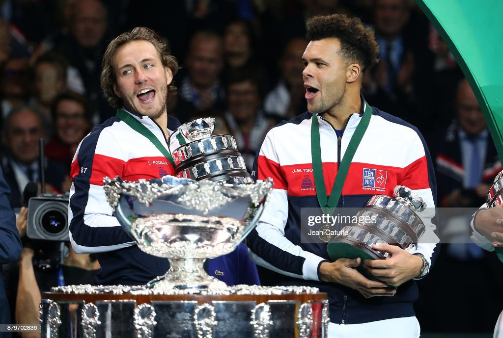 Lucas Pouille, Jo-Wilfried Tsonga of France celebrate winning the Davis Cup during the trophy presentation on day 3 of the Davis Cup World Group final between France and Belgium at Stade Pierre Mauroy on November 26, 2017 in Lille, France.