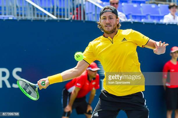 Lucas Pouille makes eye contact with the ball before returning it during his first round match at ATP Coupe Rogers on August 7 at Uniprix Stadium in...