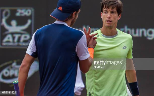 Lucas Pouille of France and Aljaz Bedene of Great Britain shake hands after the final at Gazprom Hungarian Open 2017 at National Training Center on...