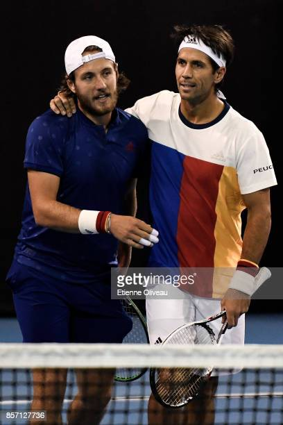 Lucas Pouille of France and Fernando Verdasco of Spain celebrate victory over Roberto Bautista Agut of Spain and Aljaz Bedene of Great Britain after...