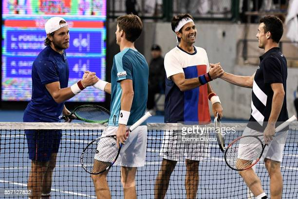 Lucas Pouille of France and Fernando Verdasco of Spain check hands with Roberto Bautista Agut of Spain and Aljaz Bedene of Great Britain after their...