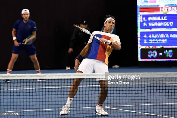 Lucas Pouille of France and Fernando Verdasco of Spain in action against Roberto Bautista Agut of Spain and Aljaz Bedene of Great Britain during...