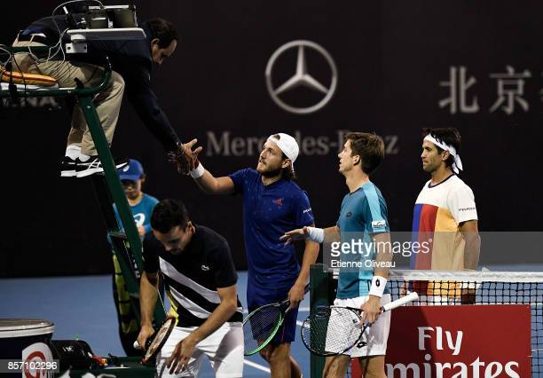 Lucas Pouille of France and Fernando Verdasco of Spain Roberto Bautista Agut of Spain and Aljaz Bedene of Great Britain greet the referee after their...
