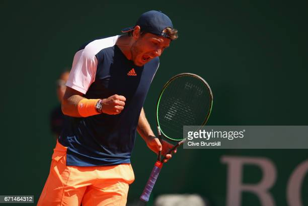 Lucas Pouille of France celebrates a point against Albert RamosVinolas of Spain in their semi final round match on day seven of the Monte Carlo Rolex...