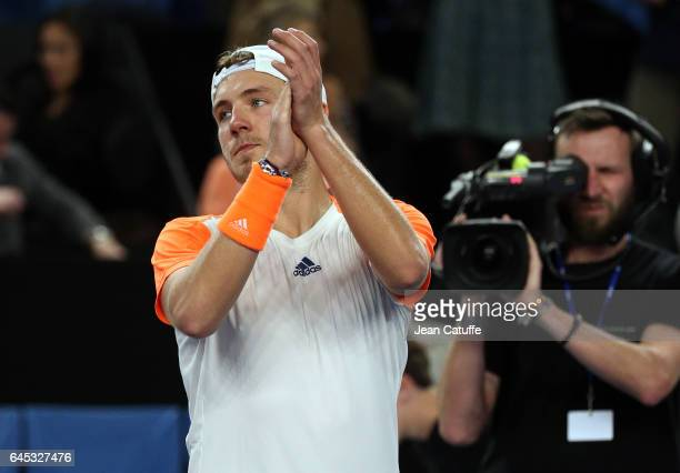 Lucas Pouille of France celebrates his semifinal victory against Richard Gasquet at the Open 13 an ATP 250 tennis tournament at Palais des Sports on...