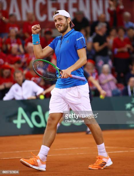 Lucas Pouille of France celebrates his victory during the singles match against Kyle Edmund of Great Britain on day one of the Davis Cup World Group...