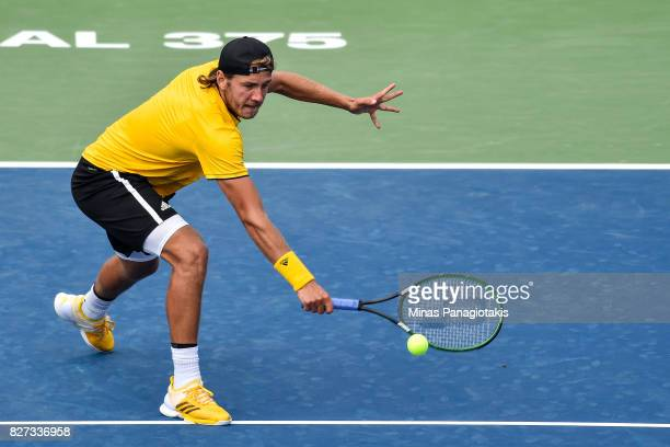 Lucas Pouille of France hits his return shot against Jared Donaldson of the United States during day four of the Rogers Cup presented by National...