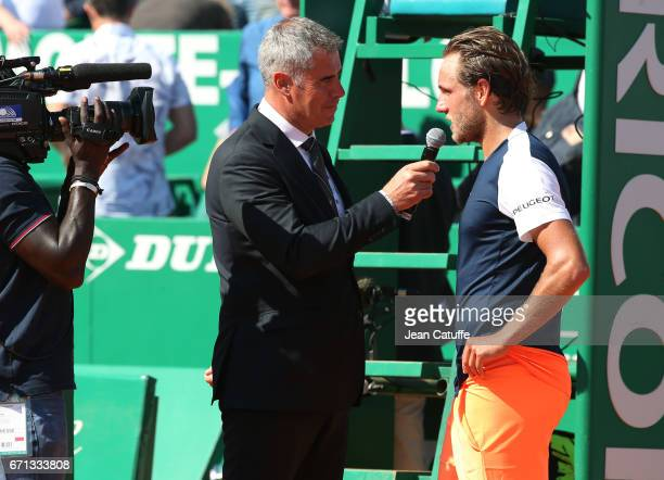Lucas Pouille of France is interviewed on court by Marc Maury after winning his quarter final on day 6 of the MonteCarlo Rolex Masters an ATP Tour...