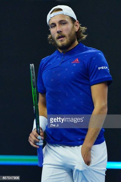 Lucas Pouille of France looks on against Rafael Nadal of Spain during the Men's singles first round on day four of 2017 China Open at the China...