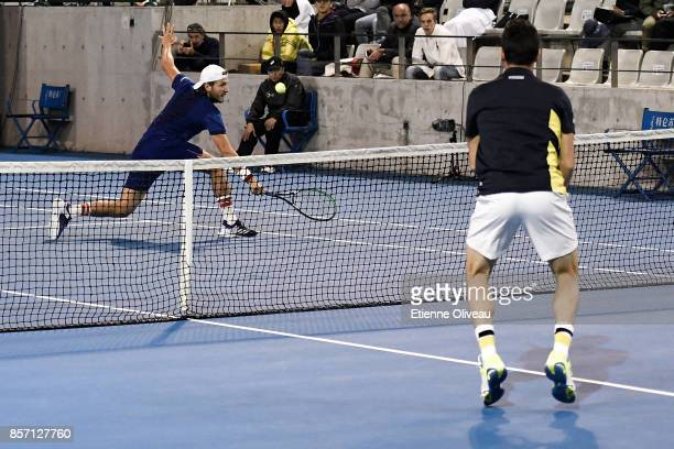 Lucas Pouille of France partner of Fernando Verdasco of Spain in action against Roberto Bautista Agut of Spain partner of Aljaz Bedene of Great...