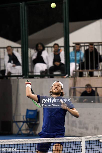 Lucas Pouille of France partner of Fernando Verdasco of Spain in action against Roberto Bautista Agut of Spain and Aljaz Bedene of Great Britain...
