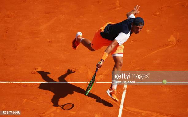 Lucas Pouille of France plays a backhand against Albert RamosVinolas of Spain in their semi final round match on day seven of the Monte Carlo Rolex...