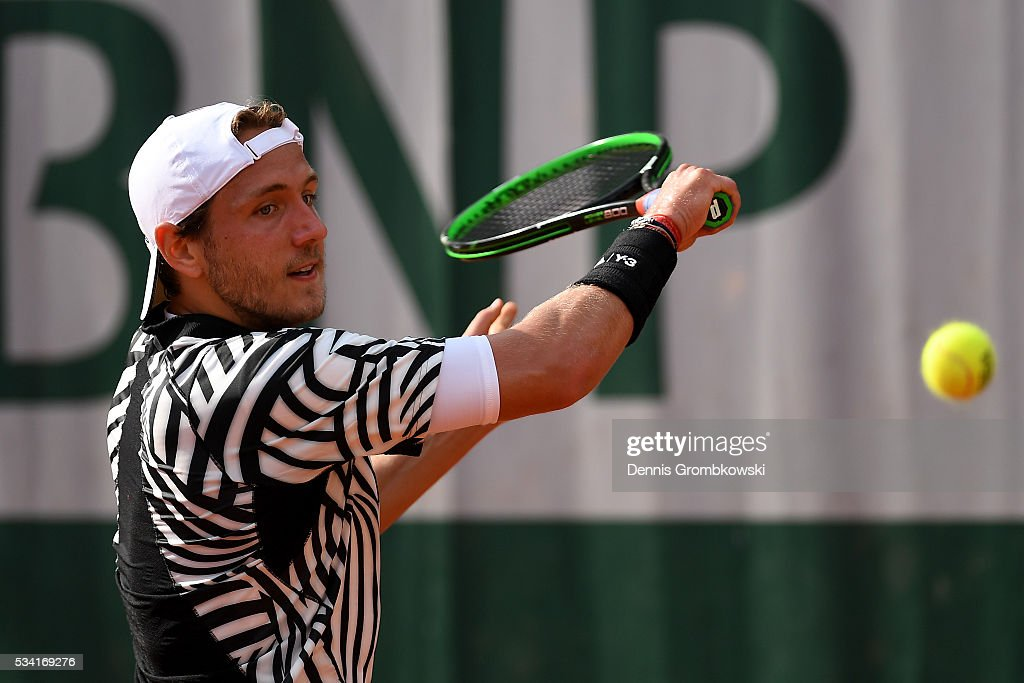 <a gi-track='captionPersonalityLinkClicked' href=/galleries/search?phrase=Lucas+Pouille&family=editorial&specificpeople=7450506 ng-click='$event.stopPropagation()'>Lucas Pouille</a> of France plays a backhand during the Men's Singles second round match against Andrej Martin of Slovakia on day four of the 2016 French Open at Roland Garros on May 25, 2016 in Paris, France.