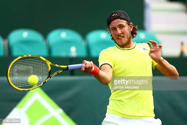 Lucas Pouille of France plays a forehand during his match against Philipp Kohlschreiber of Germany during Day 2 of The Boodles Tennis Event at Stoke...