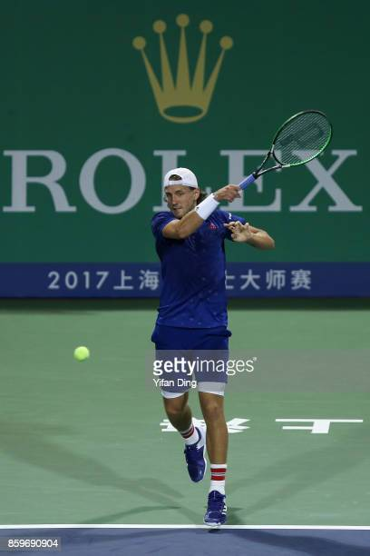 Lucas Pouille of France plays a forehand during the Men's singles mach against Fabio Fognini of Italy on day 3 of Shanghai Rolex Masters at Qi Zhong...