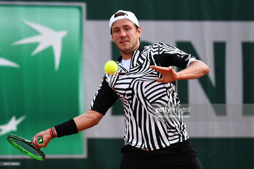 Lucas Pouille of France plays a forehand during the Men's Singles second round match against Andrej Martin of Slovakia on day four of the 2016 French Open at Roland Garros on May 25, 2016 in Paris, France.