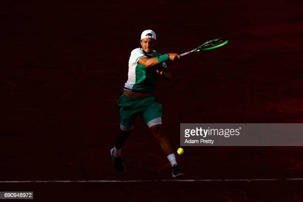 Lucas Pouille of France plays a forehand during the mens singles second round match against Thomaz Bellucci of Brazil on day four of the 2017 French...