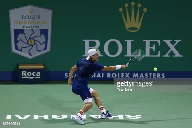 Lucas Pouille of France reaches for the ball during the Men's singles mach against Fabio Fognini of Italy on day 3 of Shanghai Rolex Masters at Qi...
