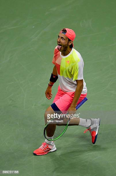 Lucas Pouille of France reacts after defeating Rafael Nadal of Spain during his fourth round Men's Singles match on Day Seven of the 2016 US Open at...
