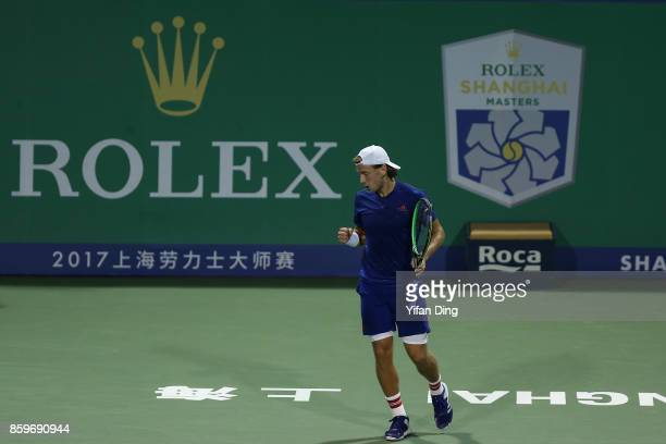 Lucas Pouille of France reacts after winning a point during the Men's singles mach against Fabio Fognini of Italy on day 3 of Shanghai Rolex Masters...