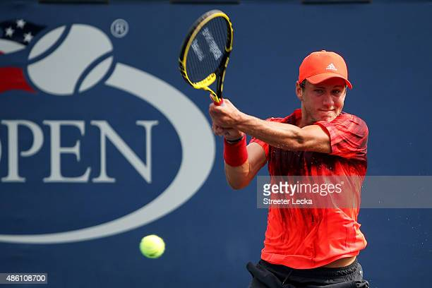 Lucas Pouille of France returns a shot against Evgeny Donskoy of Russian during their Men's Singles First Round match on Day One of the 2015 US Open...