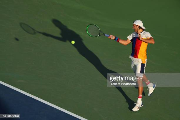 Lucas Pouille of France returns a shot against Jared Donaldson of the United States during their second round Men's Singles match on Day Three of the...