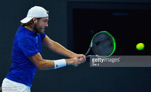 Lucas Pouille of France returns a shot against Rafael Nadal of Spain during the Men's singles first round on day four of 2017 China Open at the China...