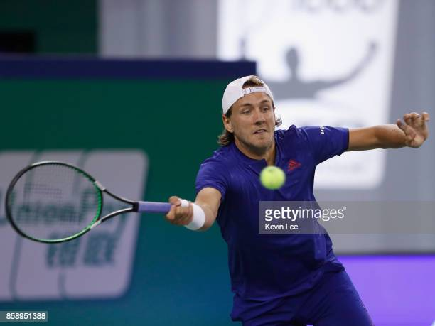 Lucas Pouille of France returns a shot to Daniil Medvedev of Russia during the First Round match on Day 1 of 2017 ATP 1000 Shanghai Rolex Masters on...
