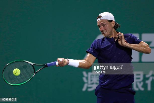 Lucas Pouille of France returns a shot to Fabio Fognini of Italy in their match during Round 1 of Men's Single on Day 3 of 2017 ATP Shanghai Rolex...