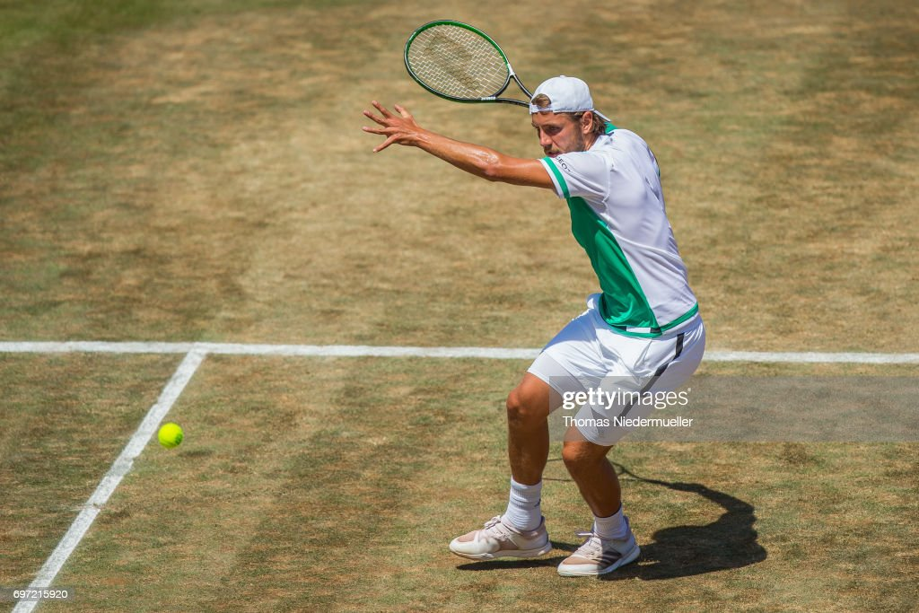 Lucas Pouille of France returns the ball during the final match between Feliciano Lopez of Spain and Lucas Pouille of France at the MercedesCup 2017 on June 18, 2017 in Stuttgart, Germany.