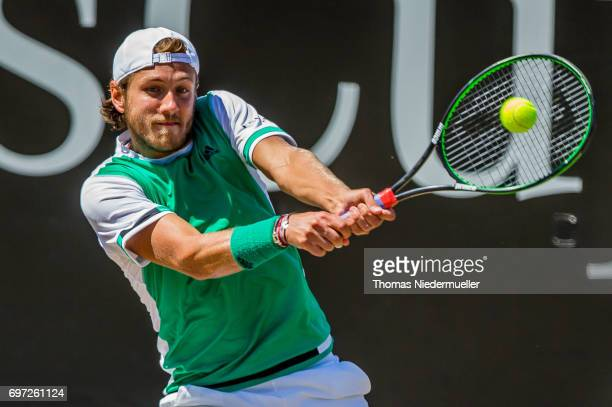 Lucas Pouille of France returns the ball during the MercedesCup men's singles final between Feliciano Lopez of Spain and Lucas Pouille of France at...