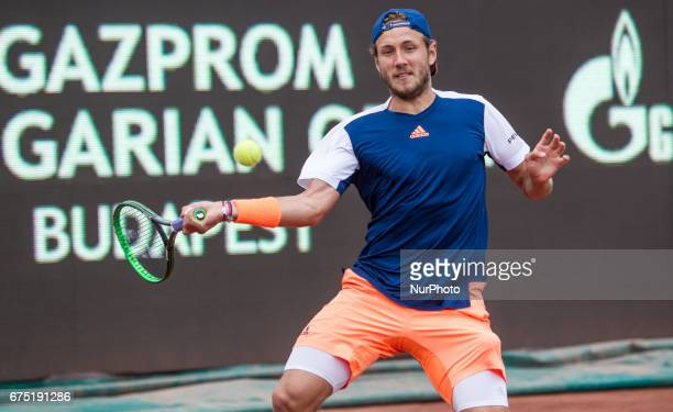 Lucas Pouille of France returns the ball in the final at Gazprom Hungarian Open 2017 at National Training Center on April 30 2017 in Budapest Hungary