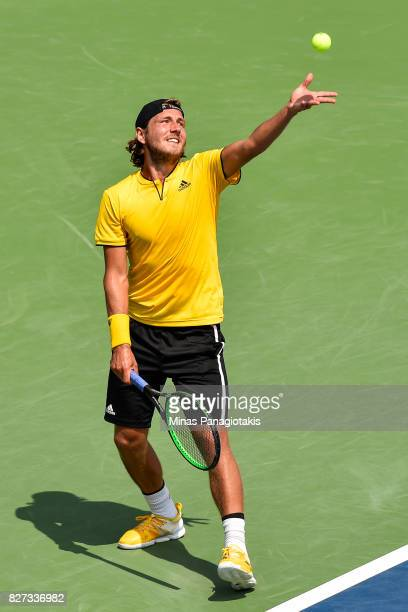 Lucas Pouille of France serves against Jared Donaldson of the United States during day four of the Rogers Cup presented by National Bank at Uniprix...