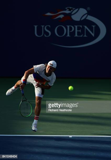 Lucas Pouille of France serves against Jared Donaldson of the United States during their second round Men's Singles match on Day Three of the 2017 US...
