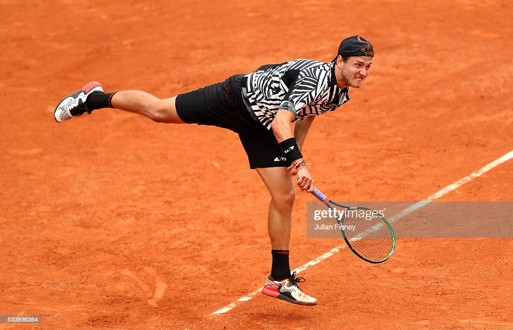 Lucas Pouille of France serves during the Men's Singles first round match against Julien Benneteau of France on day three of the 2016 French Open at Roland Garros on May 24, 2016 in Paris, France.