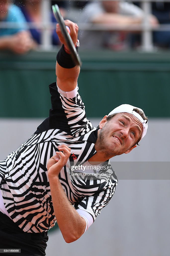 <a gi-track='captionPersonalityLinkClicked' href=/galleries/search?phrase=Lucas+Pouille&family=editorial&specificpeople=7450506 ng-click='$event.stopPropagation()'>Lucas Pouille</a> of France serves during the Men's Singles second round match against Andrej Martin of Slovakia on day four of the 2016 French Open at Roland Garros on May 25, 2016 in Paris, France.