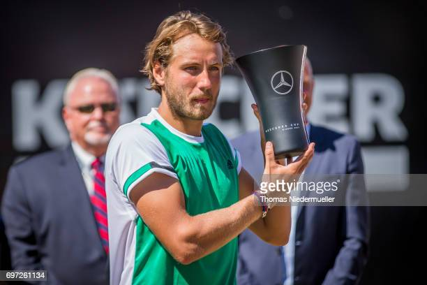 Lucas Pouille of France shows the trophy after the MercedesCup men's singles final between Feliciano Lopez of Spain and Lucas Pouille of France at...