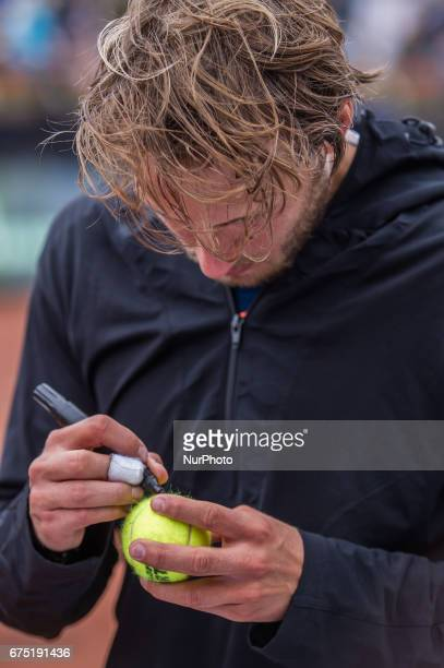 Lucas Pouille of France signs balls after the final at Gazprom Hungarian Open 2017 at National Training Center on April 30 2017 in Budapest Hungary