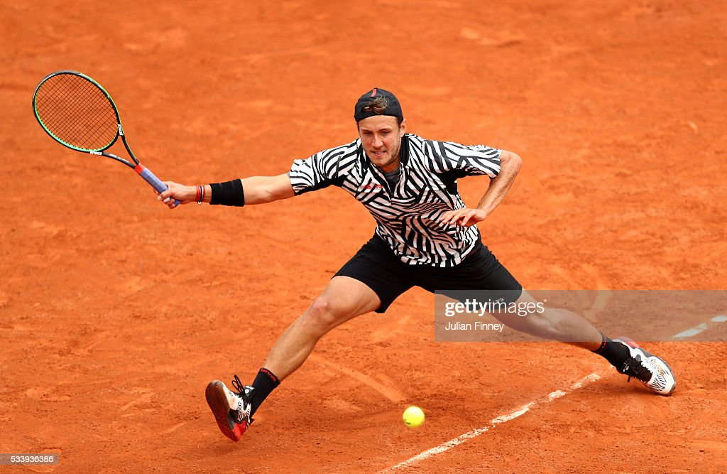 Lucas Pouille of France stretches to hit a forehand during the Men's Singles first round match against Julien Benneteau of France on day three of the 2016 French Open at Roland Garros on May 24, 2016 in Paris, France.