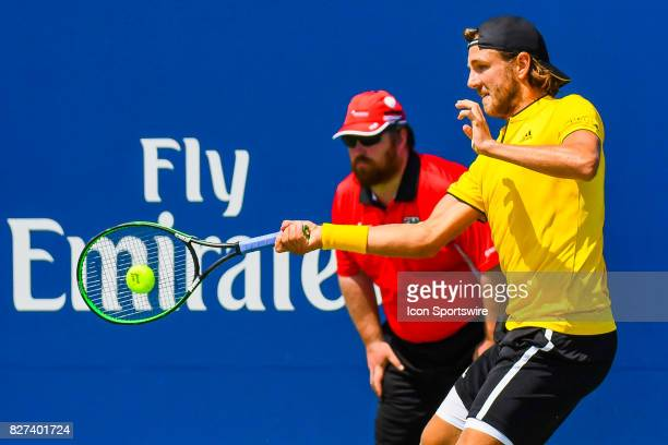 Lucas Pouille returns the ball during his first round match at ATP Coupe Rogers on August 7 at Uniprix Stadium in Montreal QC