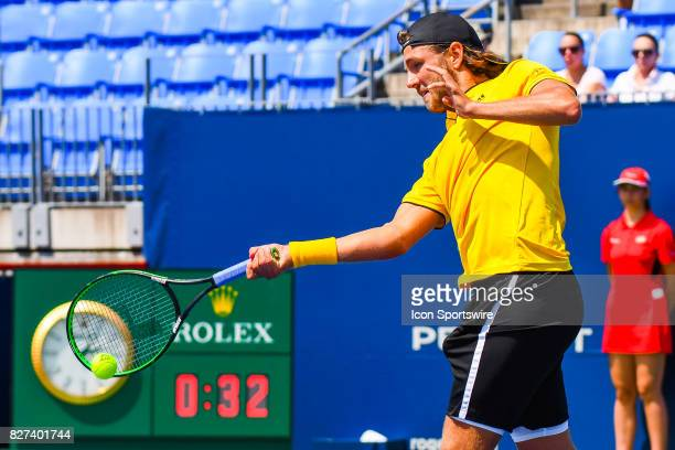 Lucas Pouille returns the ball during his first round match between at ATP Coupe Rogers on August 7 at Uniprix Stadium in Montreal QC