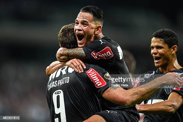 Lucas Pratto Giovanni Augusto and Douglas Santos of Atletico MG celebrates a scored goal against Sao Paulo during a match between Atletico MG and Sao...