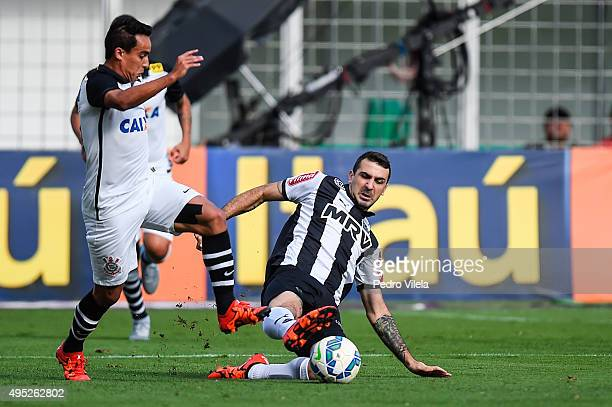 Lucas Pratto of Atletico MG and Jadson of Corinthians battle for the ball during a match between Atletico MG and Corinthians as part of Brasileirao...
