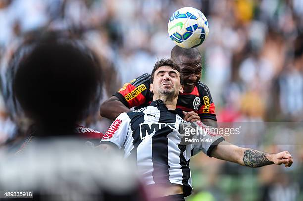 Lucas Pratto of Atletico MG and Samir of Flamengo battle for the ball during a match between Atletico MG and Flamengo as part of Brasileirao Series A...