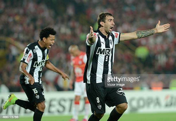 Lucas Pratto of Atletico Mineiro celebrates after scoring the opening goal during a match between Independiente Santa Fe and Atletico Mineiro as part...